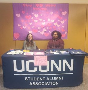 "SAA volunteers staffing the ""I Heart UConn Day"" table in the Student Union. Photo by Kassi Montenegro."